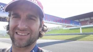 dan selfie in front of track sign